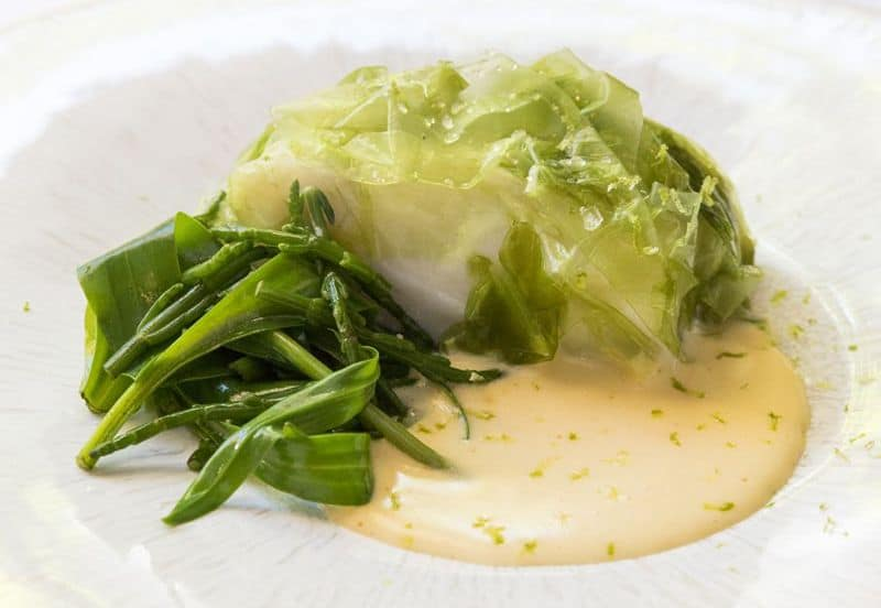 Poached cod with potatoes mousseline and sea lettuce